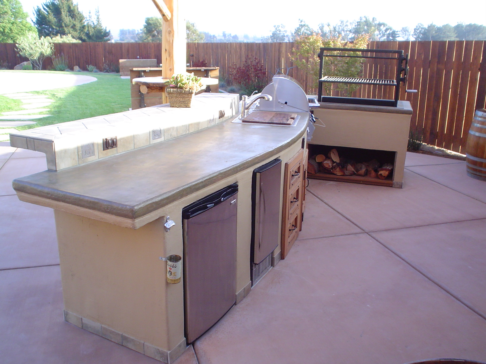 15 Outdoor Kitchen W Custom Log Arbor This Island Features Concrete Counter Tops With A Lace Stucco Finish